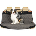 Dog sitting on a bench seat cover