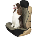 Dog sitting upright on a bucket seat cover
